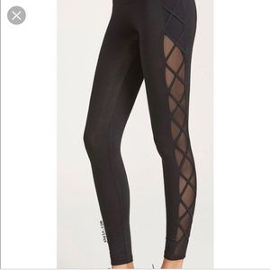 Black leggings with mesh and cross cross sides